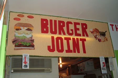 Quilted Burger Joint sign over the register