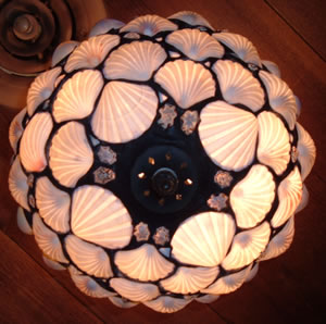 Light fixture with shell motif