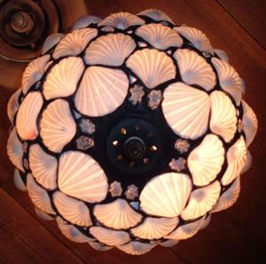 Light fixture with shell motif
