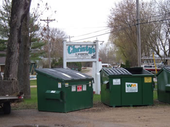 Christy's sign with Dumpsters